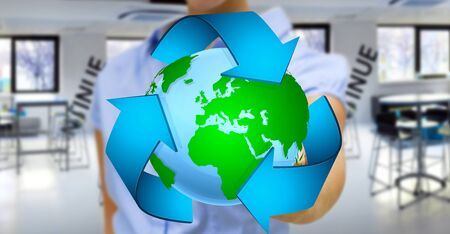 ecosistema: Businesswoman holding recycling icon and planet Earth in his hand Foto de archivo