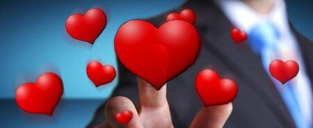 Young man touching hand drawn red heart in his hand on blurred background