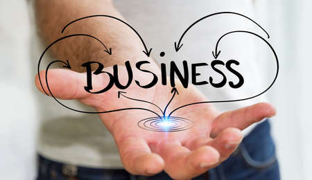 Man holding hand-drawn business presentation in his hand on blurred background