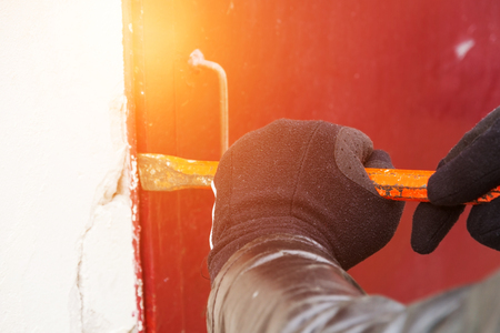 nuisance: Burglar trying to break into a house with a crowbar