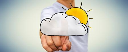 彼の指で手描き雲と太陽アイコンを触れる実業家