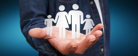 El hombre de negocios que sostiene icono de la familia en la mano