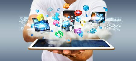 Businessman connecting cloud to tech devices and icons applications