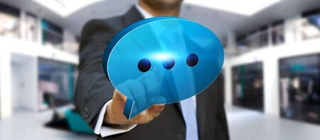 connexion: Businessman holding blue chat icon in his hand