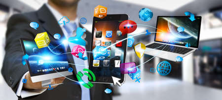 Businessman connecting colorful tech devices and icons applications
