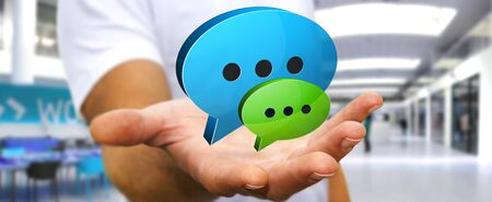 connexion: Businessman holding blue and green chat icons in his hand