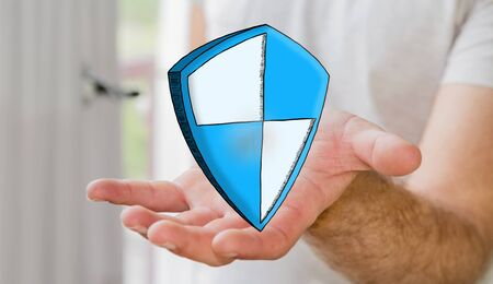 Man holding hand drawn shield safe protection in his hand Stock Photo
