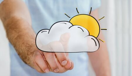 Man touching hand drawn cloud and sun icons with his finger