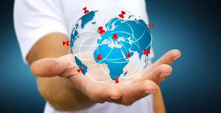 Position pin stock photos royalty free position pin images businessman with digital world map and pins floating over his hand stock photo publicscrutiny Images