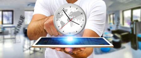 working hours: Businessman holding a big white timer over his digital tablet