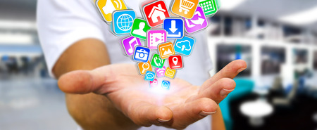 Businessman with applications icons flying over his hand