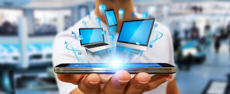 Businessman with tech devices computer phone and tablet in his hand Stock Photo