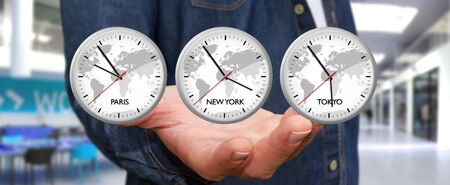 working hours: Businessman holding three big white timers from different countries in his hand Stock Photo