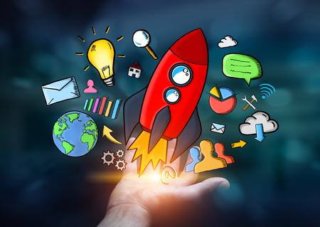 Businessman on dark background holding hand drawn rocket in his hand Stock Photo
