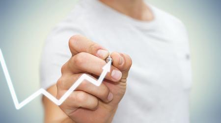 Businessman drawing digital arrow with a pen '3D rendering'