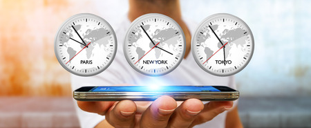 Businessman holding three big white timers from different countries over his mobile phone