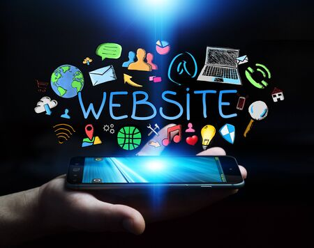 Man holding hand-drawn internet presentation over mobile phone on dark background