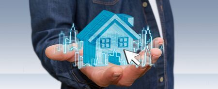 Businessman with digital house and city flying over his hands