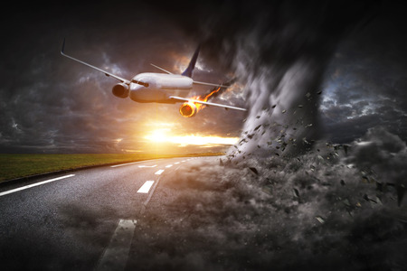explosion engine: Plane with engine on fire about to crash after hitting a tornado