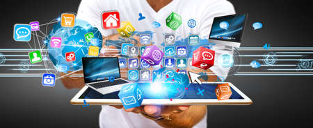 Businessman connecting tech devices and cyberspace applications Stock Photo