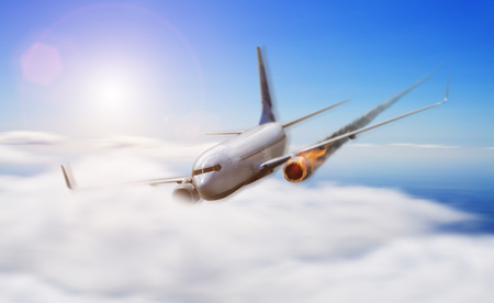explosion engine: White plane in the sky with engine on fire about to crash Stock Photo
