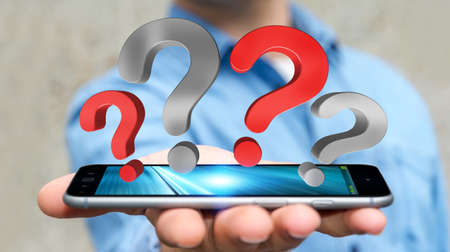 Businessman on blurred background holding question marks over mobile phone 3D rendering