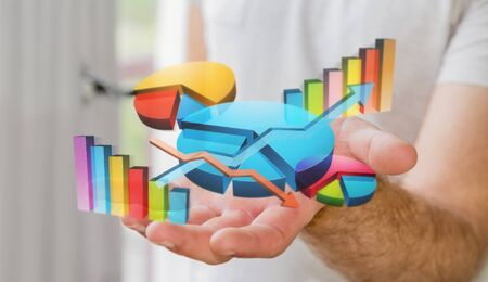 Businessman using digital 3D charts and bars interface with his hand