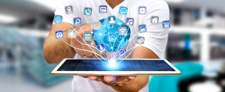 Young man using digital application with icons flying over his digital tablet