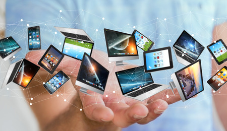 Businessman on blurred background connecting tech devices �3D rendering� Stock Photo