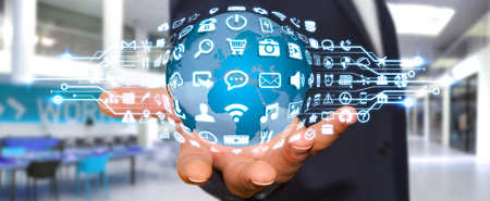 Businessman holding digital web earth with modern icons Stock Photo