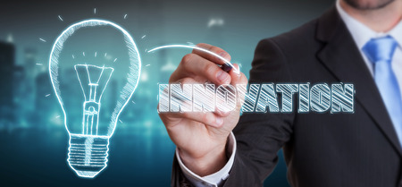 creativity and innovation: Businessman on blurred background drawing a sketch lightbulb innovation concept