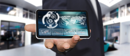 smart investing: Businessman holding multimedia tech devices in his hand