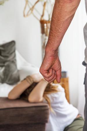 illustrating: Man beating up his wife illustrating domestic violence