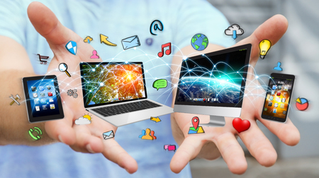 Businessman connected tech devices and icons applications with each other