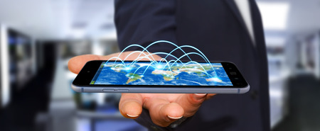 smart investing: Businessman holding mobile phone in his hand with internet connection and data exchange 3D rendering Stock Photo