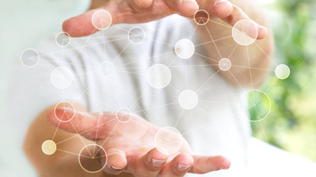 Businessman on blurred background holding circle digital data network in his hand 3D rendering