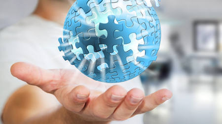 Businessman holding flying puzzle sphere in his hand �3D rendering�