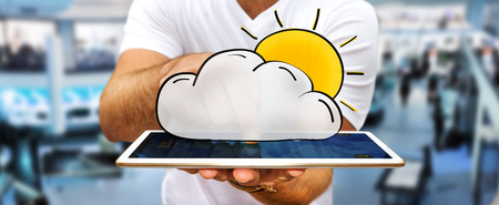 Man holding hand drawn cloud and sun icons in his hand