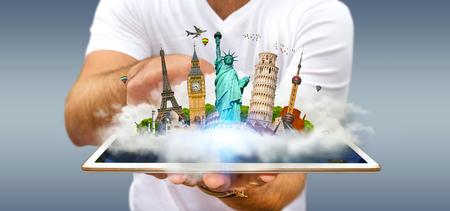 Junger Mann, der voll eine Wolke von berühmten Monumenten der Welt über seiner digitalen Tablette hält
