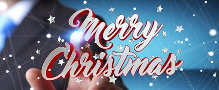 Businessman on blurred background touching floating christmas message with his finger 3D rendering Stock Photo