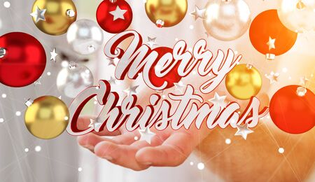 Businessman on blurred background holding floating christmas message in his hand 3D rendering
