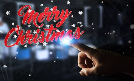 shiny gold: Businessman on blurred background touching floating christmas message with his finger 3D rendering Stock Photo