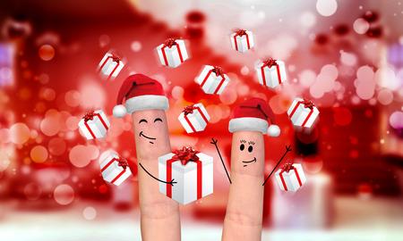 Happy finger family celebrating christmas on red background Stock Photo