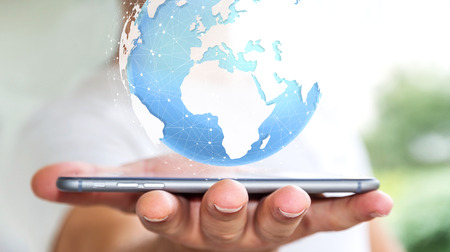 Businessman holding digital tactile world over mobiel phone'3D rendering'