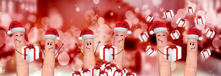 celebration smiley: Happy finger family celebrating christmas on red background Stock Photo