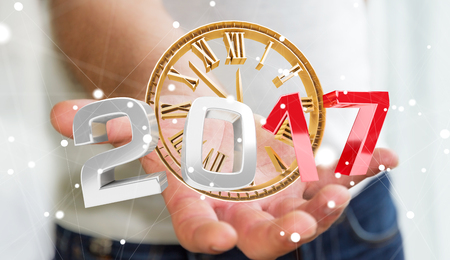 Businessman holding 2017 3D rendering text with clock in his hand