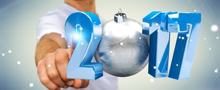 silver: Businessman touching 2017 3D rendering text with christmas ball with his finger