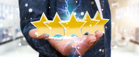 Young businessman ranking with his hand using digital stars 3D rendering Stock Photo