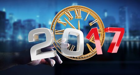 Businessman touching 2017 3D rendering text with clock with his finger Stock Photo