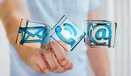 Businessman on blurred background touching transparent cube contact icon with his finger 3D rendering Stock Photo